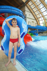 Boy with swimming toy at the water park.