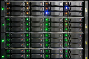 Server rack with multiple hard drives.