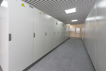 Aisle with racks of equipment for telecom.