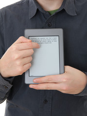 Man holding E-book reader in hands