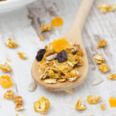 homemade pumpkin granola with dried fruit and seeds in a spoon