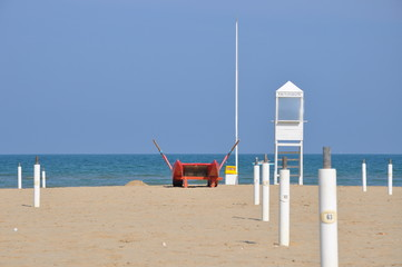 empty beach with guard tower and rescue boat in Rimini