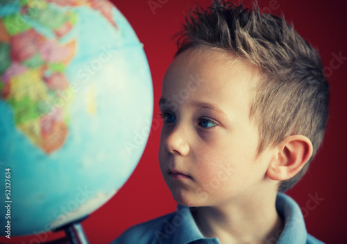 boy looking at world