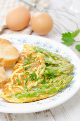 omelette with asparagus and fresh herbs, vertical
