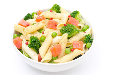 salad with pasta, smoked salmon, broccoli, green peas isolated