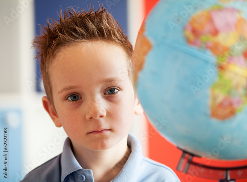 boy with africa on globe