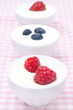 yogurt with different fresh berries in bowls