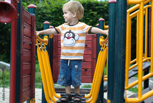 boy or kid playing  on playground.