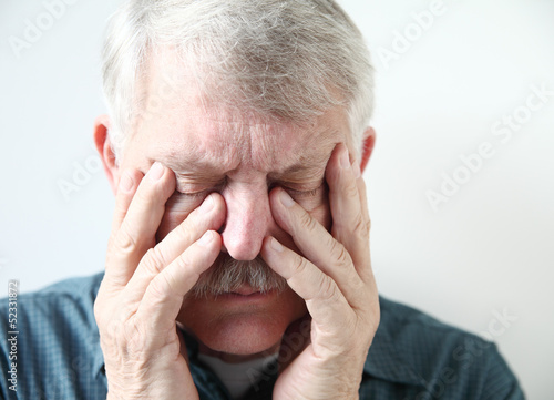 older man has pain in his sinuses