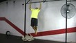 Athlete making strict pull ups crossfit exercise