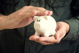 Piggy coin bank in hands