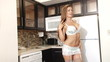 Sexy lingerie woman happy posing in the kitchen