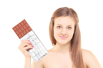 Beautiful young female holding a big chocolate