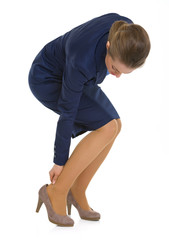 Business woman experiencing pain from shoes