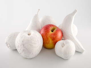Red apple with white painted fruits in white background