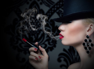 Pretty blonde girl with cigarette and red lips
