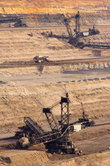 Large bucket wheel excavators digging brown-coal