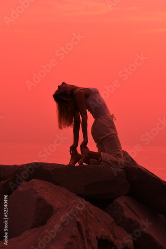 Yoga Pose at Sunset on the beach