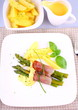 Green asparagus with ham, potato, basil and sauce