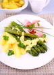 Green asparagus with prosciutto, potato, parsley and sauce
