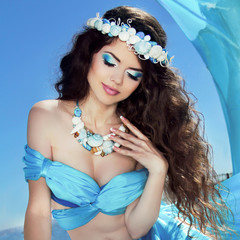 Makeup. Sea jewelry. Long Healthy Hair. Beautiful girl in blue s