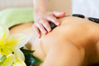 woman having wellness hot stone massage