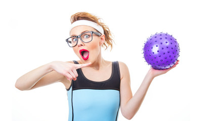 Surprised funny woman with rubber ball ready for playing
