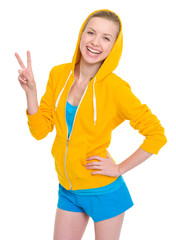 Happy teenager girl showing victory gesture