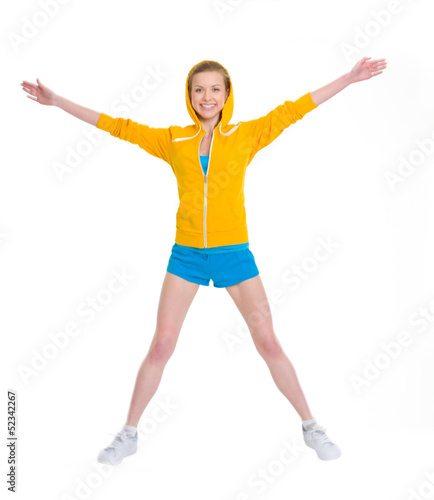 Smiling teenager girl jumping