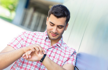 Happy guy have a date, checking the time