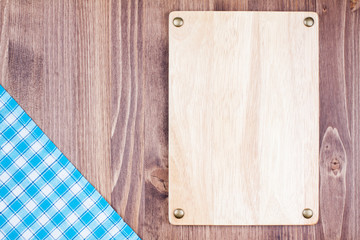 Wooden board, tablecloth on wood background