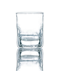 Empty vodka or whisky glass beaker isolated on white background