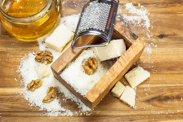 Grated Parmesan cheese. Parmesan cheese , honey and nuts