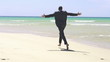 Excited businessman running on the beach, super slow motion