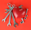 Heart and tools. Concept: Renovation of heart. On color