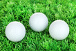 Golf balls on grass close up