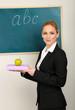 Portrait of teacher woman near chalkboard in classroom