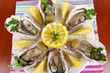 Oysters on wooden background