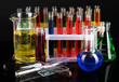 Colorful test tubes on dark background