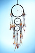 Beautiful dream catcher on blue background