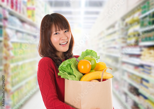 Asian woman shopping in a grocery store