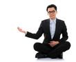 Asian business man showing blank space sit on floor