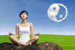 Exercise yoga outdoor under ying yang cloud