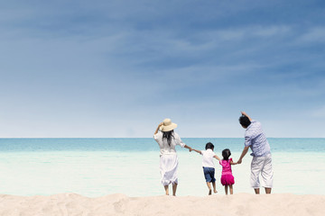 Happy family at white sand beach, Australia