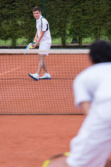 Men playing tennis