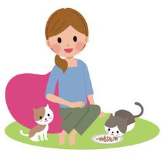 ペットに餌をあたえる女性