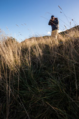 Trekker with camera