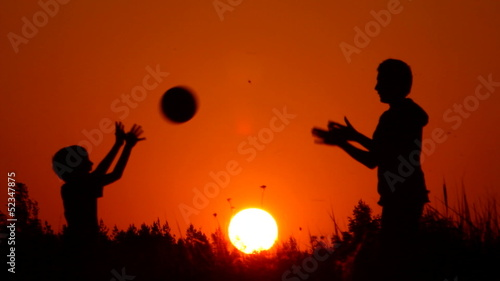silhouettes of volleyball players
