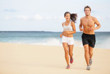 Runners - Young couple running on beach