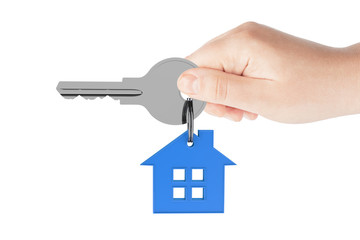 Human hand holding house key